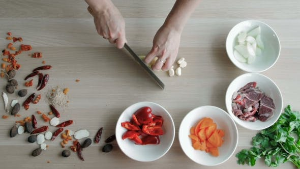 Thumbnail for Top View Of Chefs Hands Chopping Ginger On Wooden Board