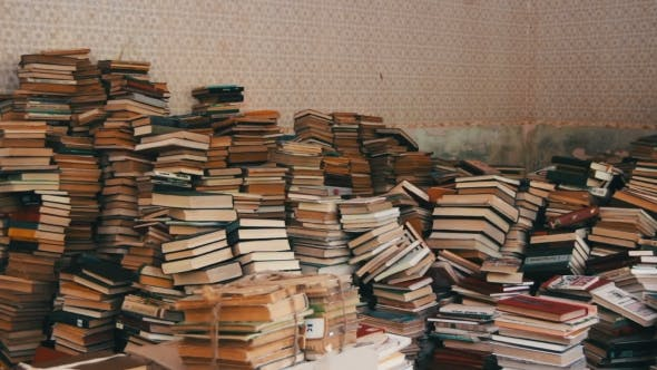 Thumbnail for Stack Of Books Scattered On The Floor In The Library