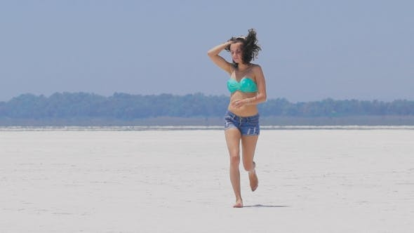 Thumbnail for A Woman Running At a Very White Salt Lake In Cyprus