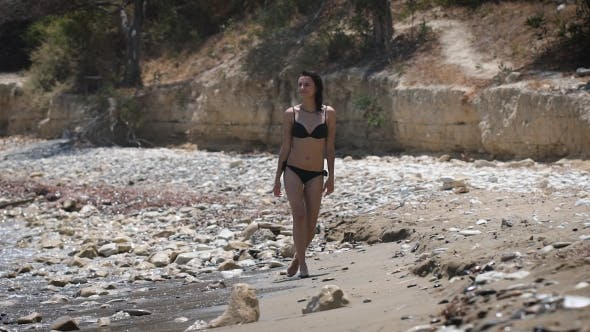 Thumbnail for A Beautiful Woman Walking At a Beach Wearing Black Bikini