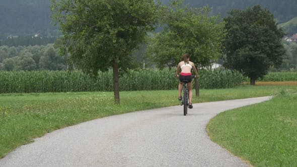 Thumbnail for Young Girl Riding Cycles On Rural Road