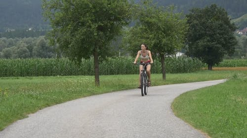 Bicycle Rider Cycles Along Bike Road In Europe