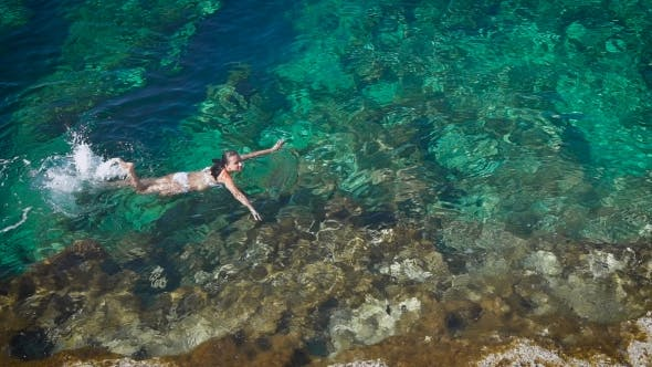 Thumbnail for Young Woman Swimming In Beautiful Azure Sea In Cyprus.