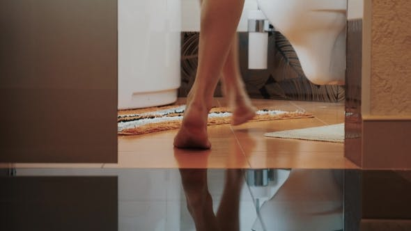 Thumbnail for Woman With Bare Legs Walk In Bathroom And Stay At Toilet. Put Off Underwear