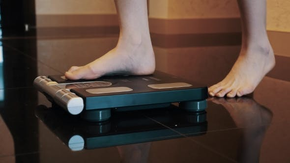 Thumbnail for Woman Stand Up On Black Modern Scales In Apartment. Bare Legs. Weighing.