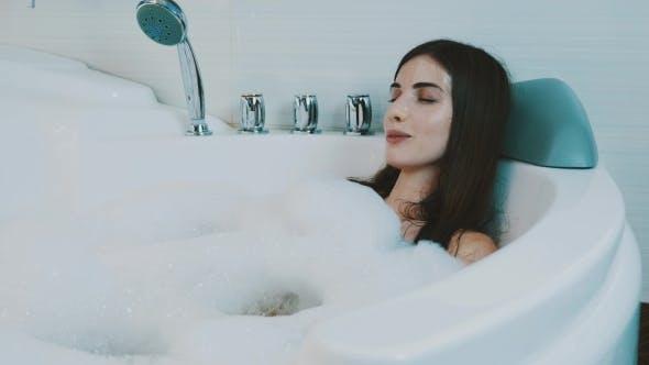 Thumbnail for Girl Petting Herself In Bathtub Full Of Foam
