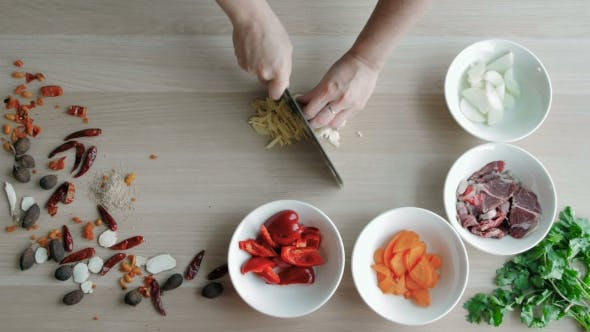 Thumbnail for Top View Of Chefs Hands Chopping Ginger And Garlic On Wooden Board, Healthy Food Concept