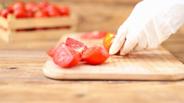 Thumbnail for Girl Cuts Tomatoes