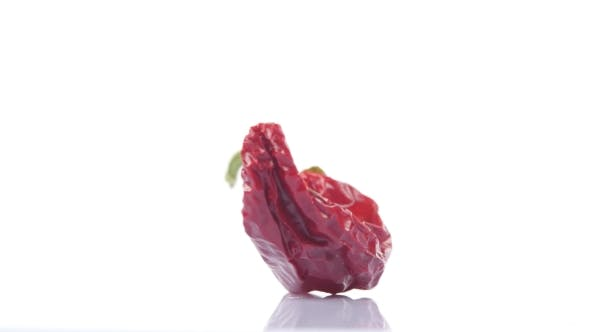 Thumbnail for Dried Red Hot Chili Peppers On White Background. Rotating.