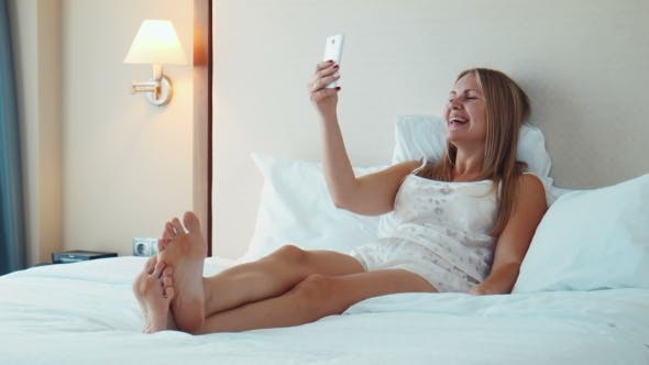 Thumbnail for Smiling Blonde Woman Has Videocall With Smartphone