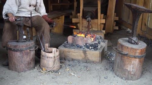 Blacksmith Working At Smithy