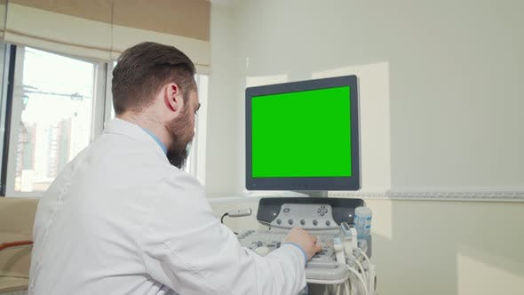 Thumbnail for Doctor Operating Ultrasound Scanner with Green Screen