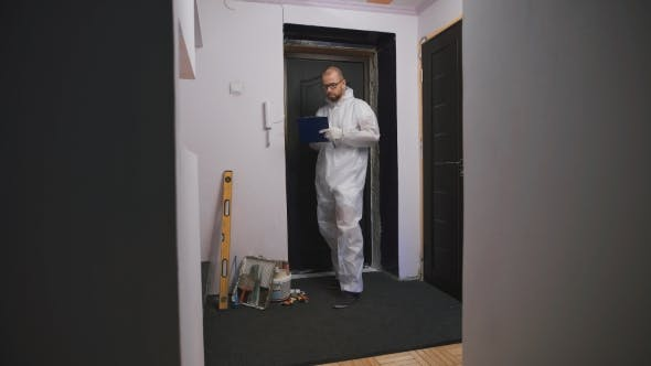 Thumbnail for Worker In Overalls, Takes Measurements Of The Doorway, He Was a Professional Builder.