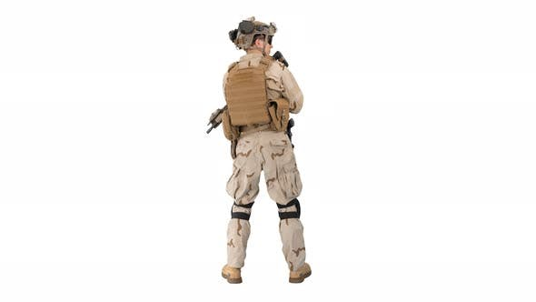 Fully Equipped Solder Holding Assault Rifle and Standing Looking To the Sides on White Background