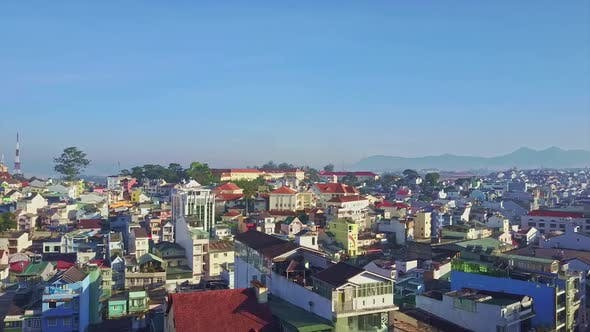 Thumbnail for Drone Shows Modern Nice City in Early Morning Against Blue Sky