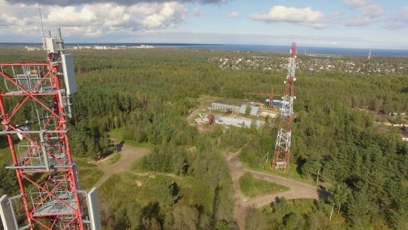 Thumbnail for Aerial view of a telecommunication cell phone tower standing in the forest