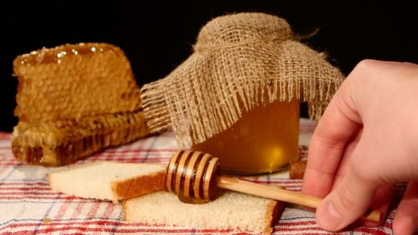 Thumbnail for Honey Spoon Dripper, Jar With Stick Pouring Over Toast Bread, Honeycomb On Black