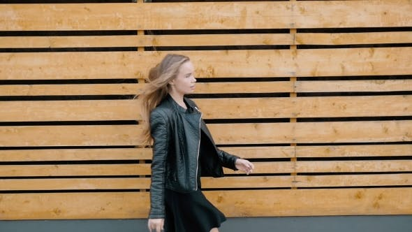Thumbnail for Portrait Of a Very Happy Young Woman In Stylish Clothes And Leather Jacket In Park