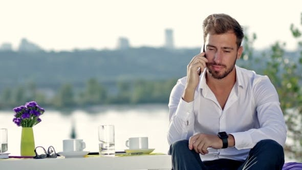 Thumbnail for Handsome Man Talking On The Phone Outdoors