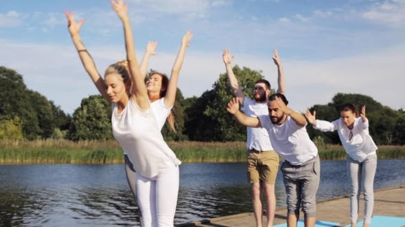 Thumbnail for Group Of People Making Yoga Exercises Outdoors 3