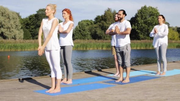 Thumbnail for Group Of People Making Yoga Exercises Outdoors 7
