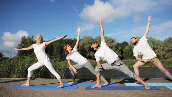 Thumbnail for Group Of People Making Yoga Exercises Outdoors 22