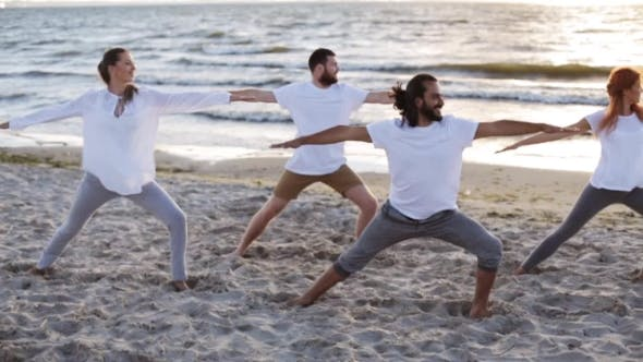 Thumbnail for Group Of People Making Yoga Exercises On Beach 33