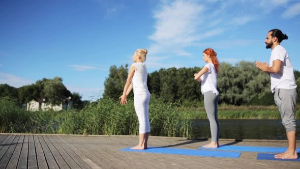Thumbnail for Group Of People Making Yoga Exercises Outdoors 59