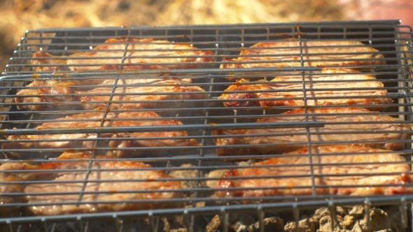 Thumbnail for Grilled Pork Steaks Over Flames And Coals, On The Brazier