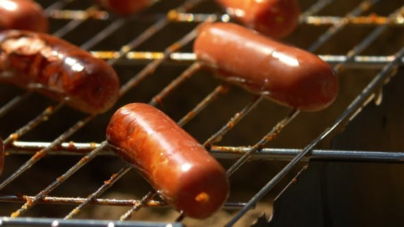 Barbecue Browned Sausages On The Hot Grill, Turn And Put,