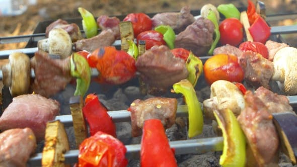 Thumbnail for Assorted Meat From Chicken, Pork And Various Vegetables For Barbecue On Grill, Turning Around,