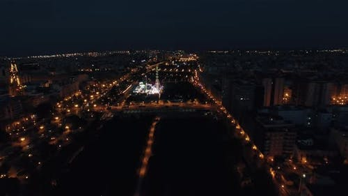 Aerial view of night Valencia with fun fair in park