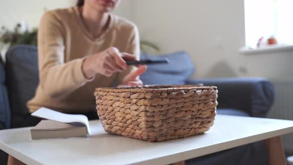 Thumbnail for Millennial Girl at Home Refuse Using Phone and Reading a Book