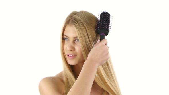 Beautiful Blond Brushing Her  Hair