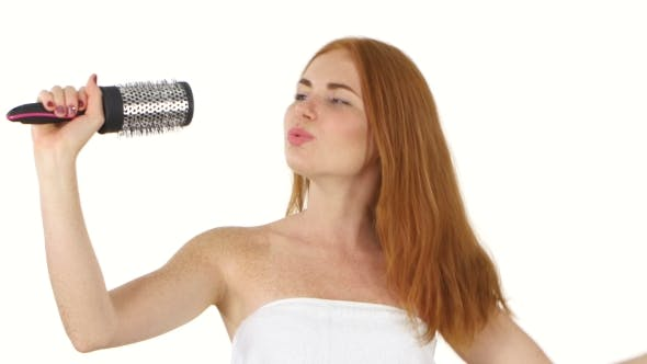 Thumbnail for Young Girl Singing Using a Brush As a Microphone, Bathroom