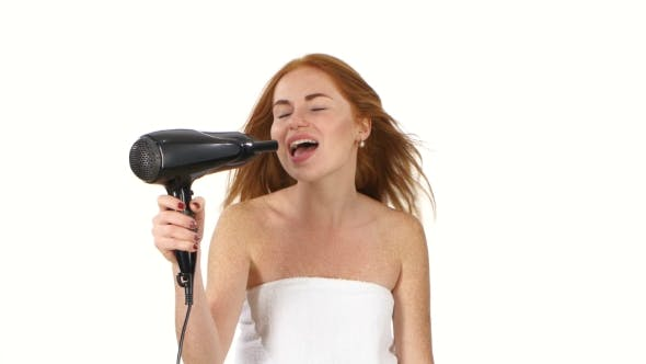 Thumbnail for Smiling Young Redhead Girl Singing While Blow-dry, Bathroom