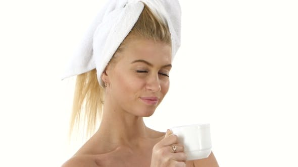 Thumbnail for Girl Is Drinking Coffee. She Is Standing And Gently Smiling, Bathroom