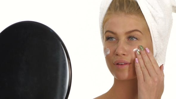 Thumbnail for Beautiful Young Woman Applying Face Cream. , Bathroom