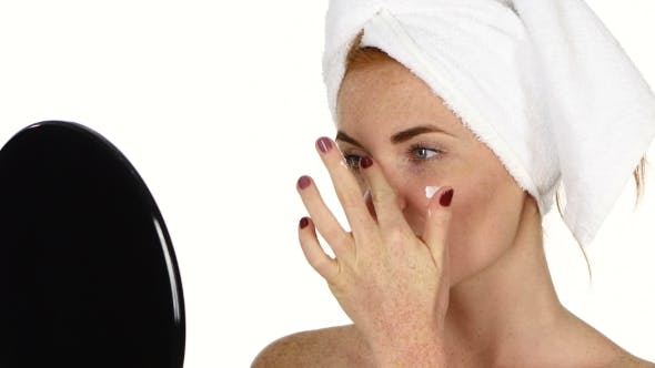 Thumbnail for Young Woman Applying Face Cream, Bathroom