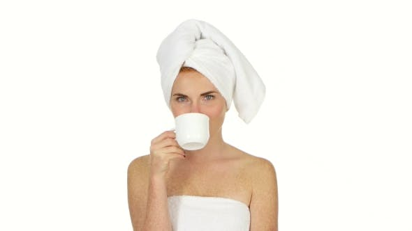 Thumbnail for Girl Is Drinking Coffee. Her Eyes Are Closed With Pleasure And She Has Towel On Her Head.
