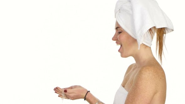 Cover Image for Young Female Washing Her Face With Clear Water, Bathroom