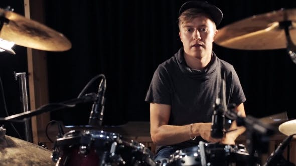 Cover Image for Male Musician Playing Drums And Cymbals At Studio 14