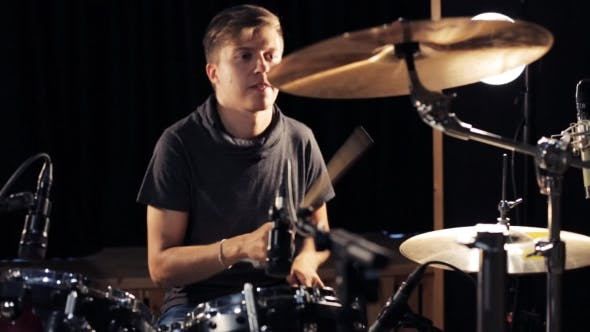 Cover Image for Male Musician Playing Drums And Cymbals At Studio 15