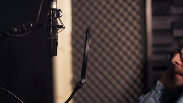 Thumbnail for Man With Headphones Singing At Recording Studio 30