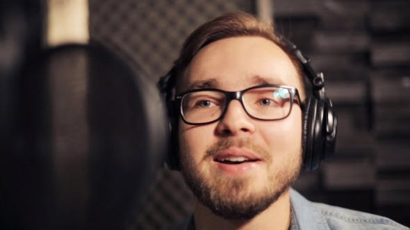 Thumbnail for Man With Headphones Singing At Recording Studio 36