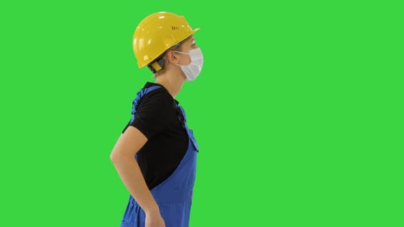 Thumbnail for Female Construction Worker in Overalls and in Medical Mask Walking on a Green Screen, Chroma Key.