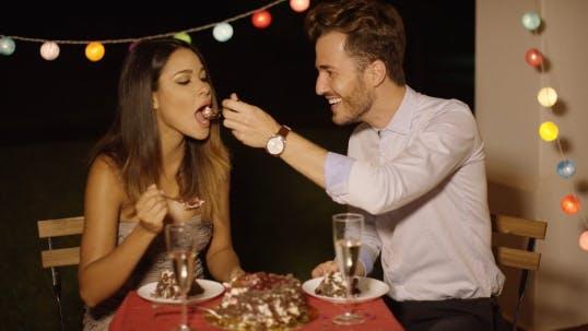 Thumbnail for Loving Young Man Feeding His Girlfriend Cake