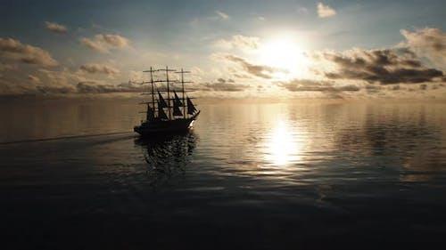Tall Ship. Sailboat. Silhouette. Open sea. Ocean. Travel. Freedom. Aerial 4k.