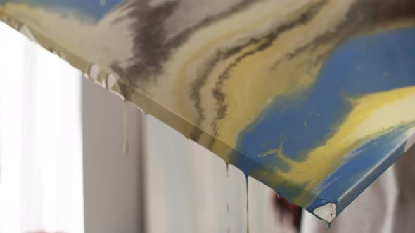 Thumbnail for Female Artist Making Paint Flow off Canvas