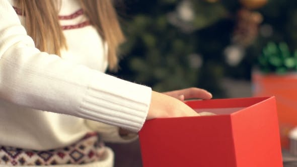 Thumbnail for Beautiful Smiling Girl Open Christmas Gift